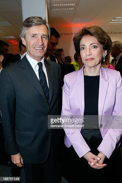 President of L'Opinion Nicolas Beytout and French Minister of Health Marisol Touraine attend 'L'Opinion' Newspaper Launch Party on May 14 2013 in...