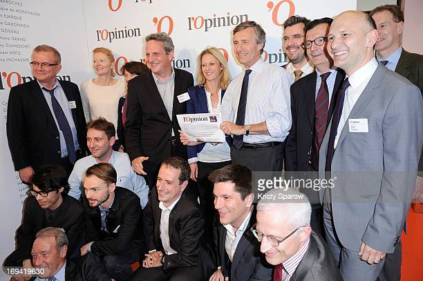 President of L'Opinion Nicolas Beytout and journalists attend the 'L'Opinion' Newspaper Launch Party on May 14 2013 in Paris France