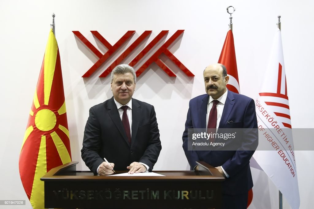 President of Macedonia Gyorge Ivanov (L) signs the guestbook during his visit to Chairman of the Council of Higher Education of Turkey, Prof. Dr. Yekta Sarac (R) in Ankara, Turkey on February 21, 2018.