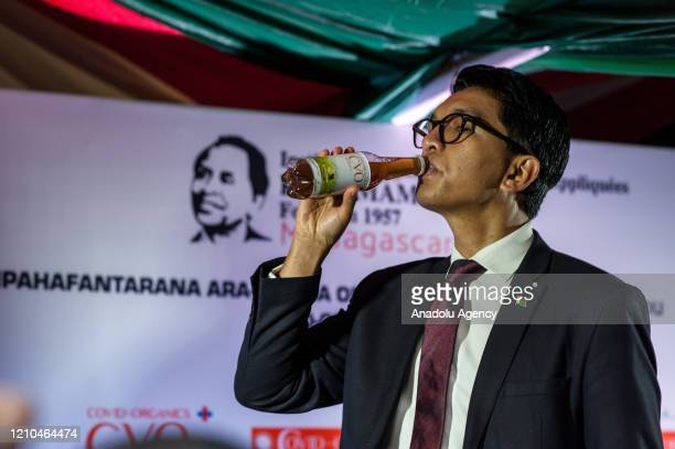 President of Madagascar Andry Rajoelina drinks a Covid Organics a herbal medicine which allegedly being developed against coronavirus during a press...