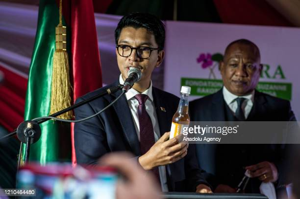 President of Madagascar Andry Rajoelina shows a Covid Organics a herbal medicine which allegedly being developed against coronavirus during a press...