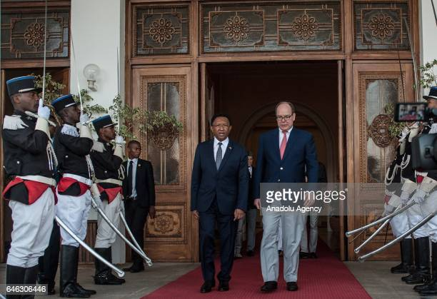 President of Madagascar Hery Rajaonarimampianina and Prince of Monaco Albert II walk past honor guards during their meeting at Presidential Palace in...