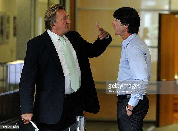 President of Mainz 05 and member of executive committee of German Football Association Harald Strutz is talking with head coach Joachim Loew during...