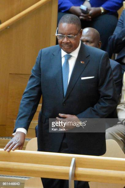 President of Malawi Peter Mutharika bows from the gallery of the Scottish Parliament in acknowledgment of applause by MSPs during a visit to the...