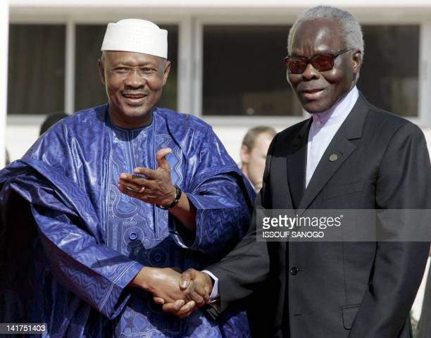 President of Mali Amadou Toumani Toure welcomes Benin's President Mathieu Kerekou during the opening of the twoday AfricaFrance Summit in Bamako 03...