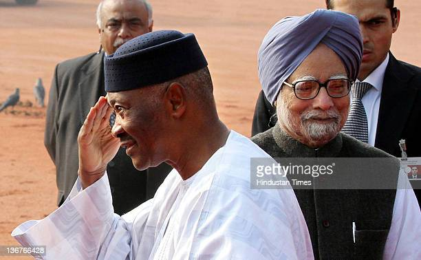 President of Mali Amadou Toumani Toure with the Indian Prime Minister Manmohan Singh during his ceremonial reception at the Presidential Palace on...