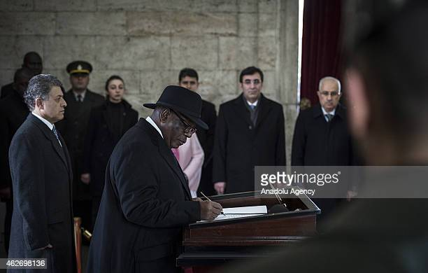 President of Mali Ibrahim Boubacar Keita signs a guest book during his visit to Anitkabir the mausoleum of Turkey's founder Mustafa Kemal Ataturk on...