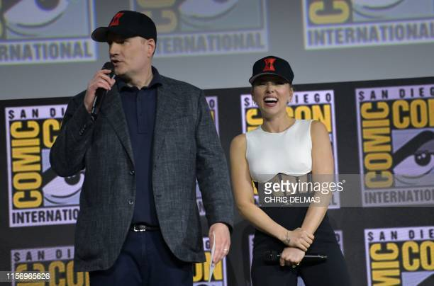 """President of Marvel Studios Kevin Feige and US actress Scarlett Johansson present the movie """"Black Widow"""" on stage during the Marvel panel in Hall H..."""