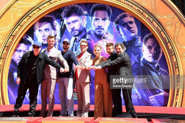 President of Marvel Studios/Producer Kevin Feige Chris Hemsworth Chris Evans Robert Downey Jr Scarlett Johansson Jeremy Renner and Mark Ruffalo poses...