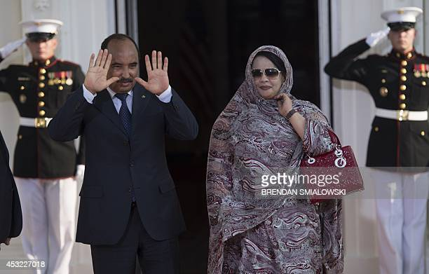 President of Mauritania Mohamed Ould Abdel Aziz waves upon arrival at the White House for a group dinner during the US Africa Leaders Summit August 5...