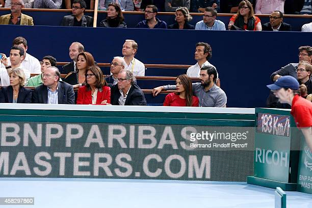 President of Medef Pierre Gattaz and his wife Michel Leeb and his wife Beatrice singer Sofia Essaidi and her companion attend the Final match during...