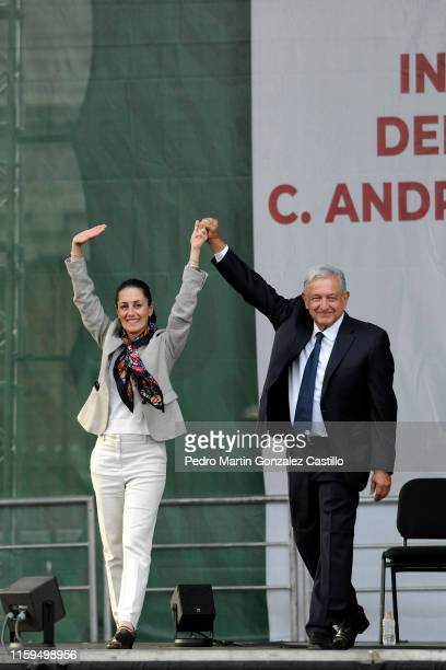 President of Mexico Andres Manuel Lopez Obrador and Claudia Sheinbaum salute during a ceremony to celebrate his administration's first anniversary at...