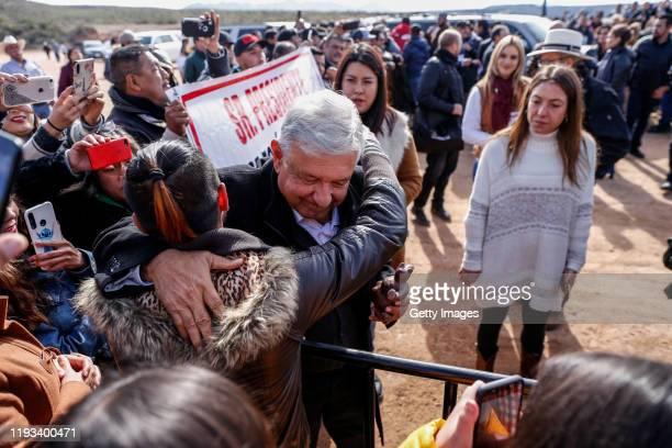 President of Mexico Andrés Manuel López Obrador hugs a member of La Mora during a visit on January 12 2019 in Bavispe Sonora President Lopez Obrador...