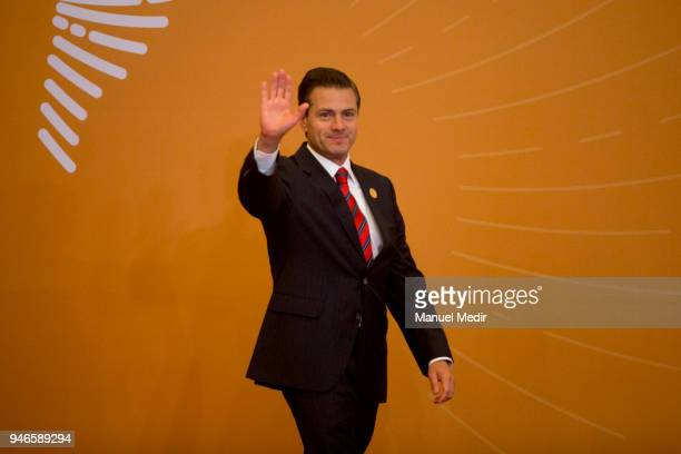 President of Mexico Enrique Peña Nieto greets the press during Day 2 of the VIII Summit of The Americas on April 14 2018 in Lima Peru