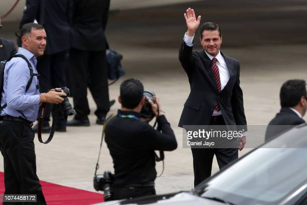 President of Mexico Enrique Peña Nieto waves as he arrives to Buenos Aires for G20 Leaders' Summit 2018 at Ministro Pistarini International Airport...