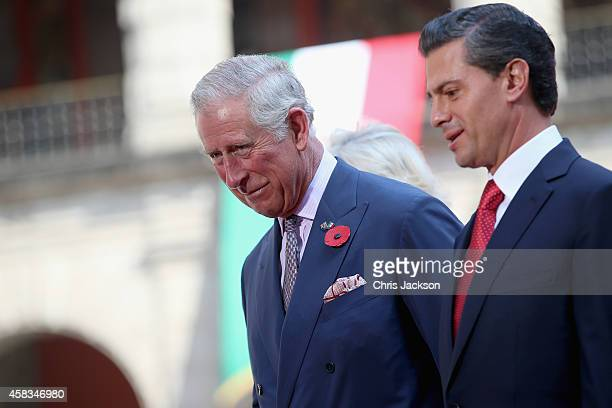 President of Mexico Enrique Pena Nieto and Prince Charles Prince of Wales during an official welcome at the National Palace on November 3 2014 in...