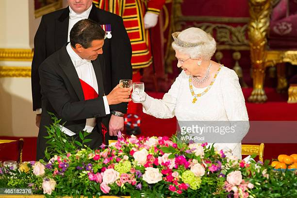 President of Mexico Enrique Pena Nieto and Queen Elizabeth II make a toast during a state banquet at Buckingham Palace on March 3 2015 in London...