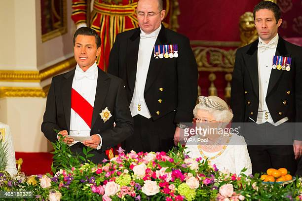 President of Mexico Enrique Pena Nieto speaks alongside Queen Elizabeth II during a state banquet at Buckingham Palace on March 3 2015 in London...