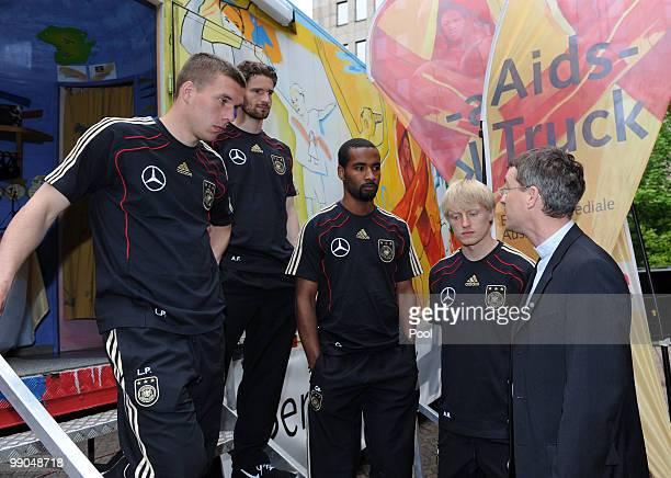 President of Missio Klaus Kraemer talks to players of team Germany Lukas Podolski Arne Friedrich Cacau and Andreas Beck during their visit of the...