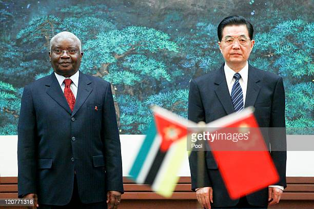 President of Mozambique Armando Guebuza and Chinese President Hu Jintao stand together during a signing of agreements at the Great Hall of the People...