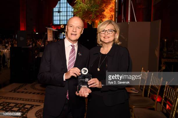 President of MSNBC Phil Griffin poses with an award presented by Journalist Cynthia McFadden during the International Women's Media Foundation's 2018...