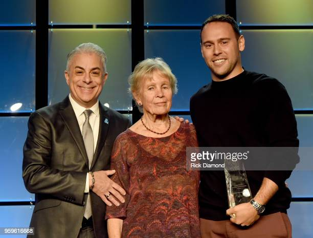 President of Music Business Association James Donio and Sandra Chapin present an award to owner of School Boy Records and RBMG Scooter Braun and take...