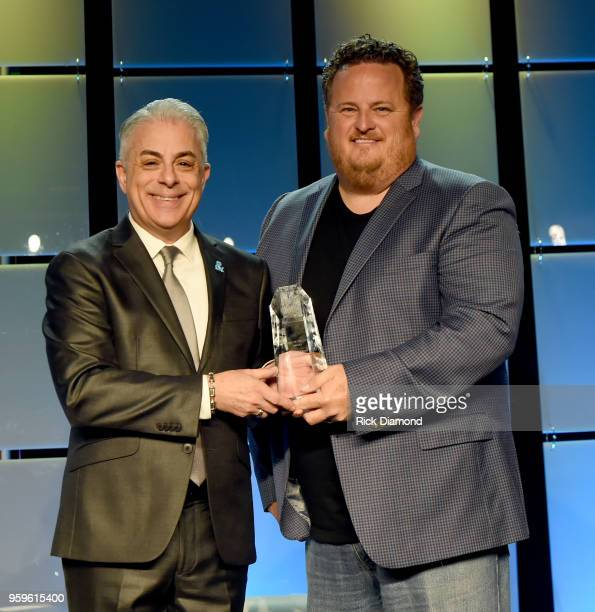 President of Music Business Association James Donio presents an award to Scott Wagner of Atlantic Records onstage during the Music Biz 2018 Awards...