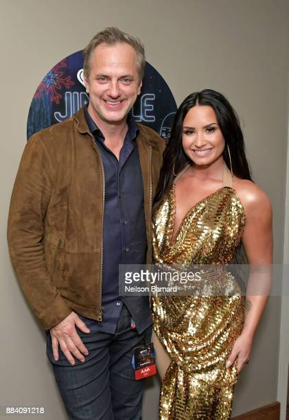 President of National Programming Group for iHeartMedia Tom Poleman and Demi Lovato attend 1027 KIIS FM's Jingle Ball 2017 presented by Capital One...