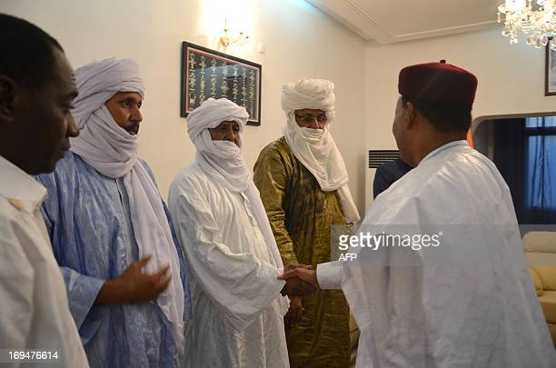 President of Niger Mahamadou Issoufou , greets a member of a delegation of the High Council of the Azawad, a territory in northern Mali, led by...