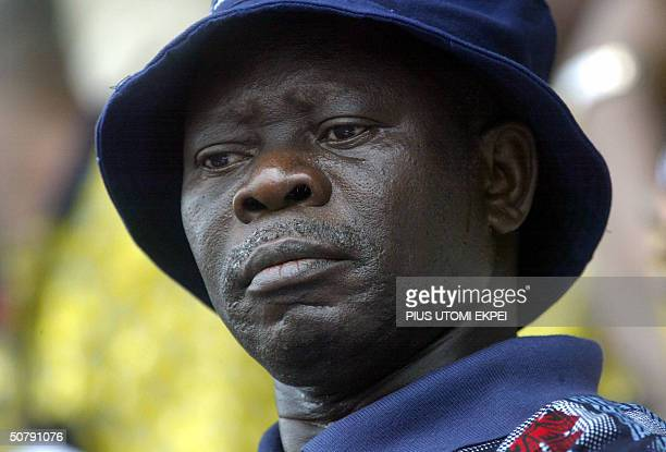 President of Nigeria Labour Congress Adams Oshiomhole watches workers march 01 May 2004 during a workers' rally at the Lagos National Stadium...