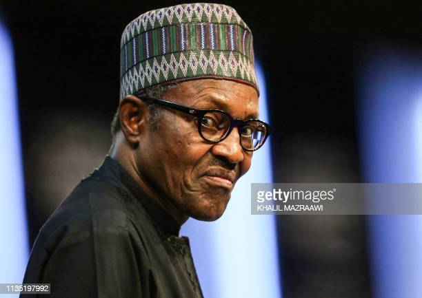 President of Nigeria Muhammadu Buhari looks on as he attends the opening ceremony of the 2019 World Economic Forum on the Middle East and North...