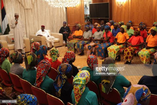 President of Nigeria Muhammadu Buhari speaks with the relatives of abducted girls after the releasing 82 of school girls kidnapped by Boko Haram in...