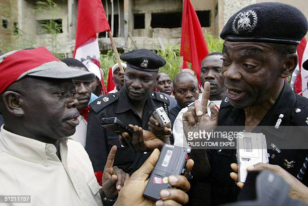 President of Nigeria's Labour Congress Adams Oshiomhole is warned by Police Commissioner Lawrence Alobi 24 August 2004 not to lead workers to a...