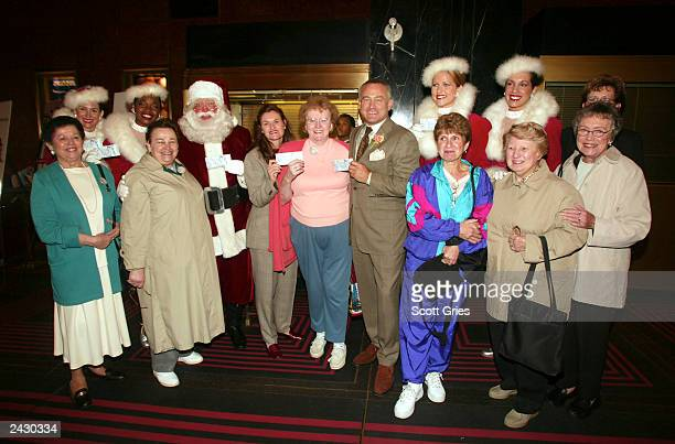 President of NYC & Company Cristyne Nicholas and President of Radio City Entertainment & Madsion Square Garden Seth Abraham with Santa Claus, The...