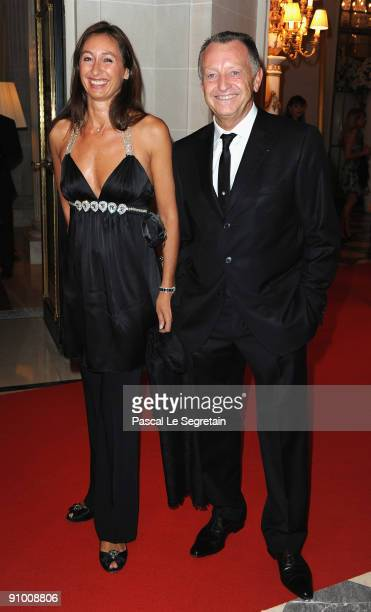 President of Olympique Lyonnais football club JeanMichel Aulas and wife pose as they arrive to attend the 'Par Coeur Gala' dinner at the Hotel...