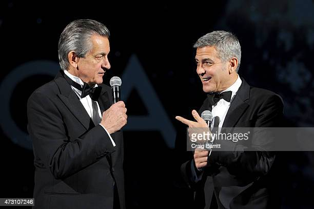 President of OMEGA Stephen Urquhart and Brand Ambassador George Clooney speak onstage during the OMEGA Speedmaster Houston Event at Western Airways...