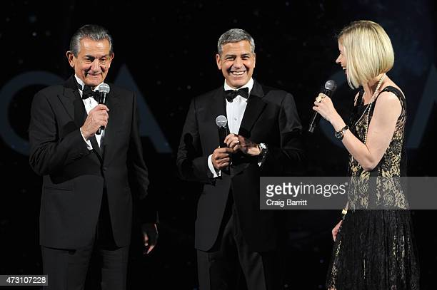 President of OMEGA Stephen Urquhart Brand Ambassador George Clooney and writer Lily Koppel speak onstage during the OMEGA Speedmaster Houston Event...