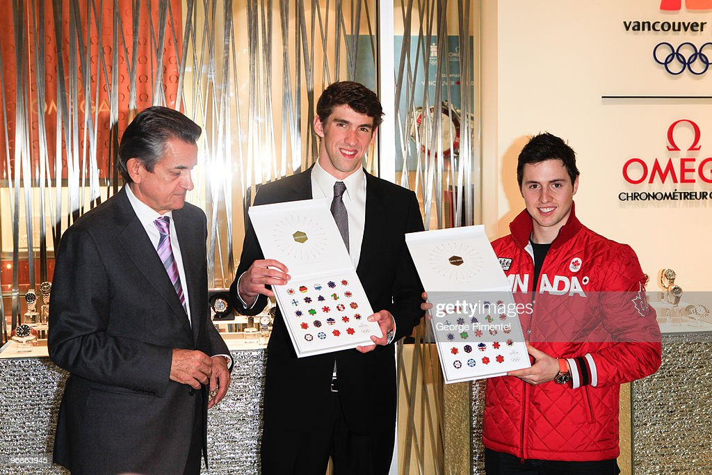President of OMEGA Stephen Urquhart with Olympic Gold Medalists Michael Phelps (M) and Alexandre Bilodeau (R) attend the OMEGA Cocktail Celebration at the Fairmont Hotel on February 18, 2010 in Vancouver, Canada.