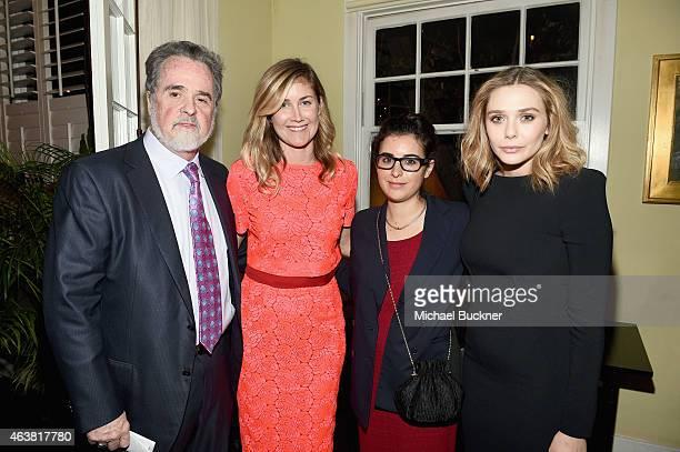 President of Oxfam Raymond Offenheiser Oxfam senior advisor public figures Lyndsay Cruz guest and actress Elizabeth Olsen attend VANITY FAIR and...