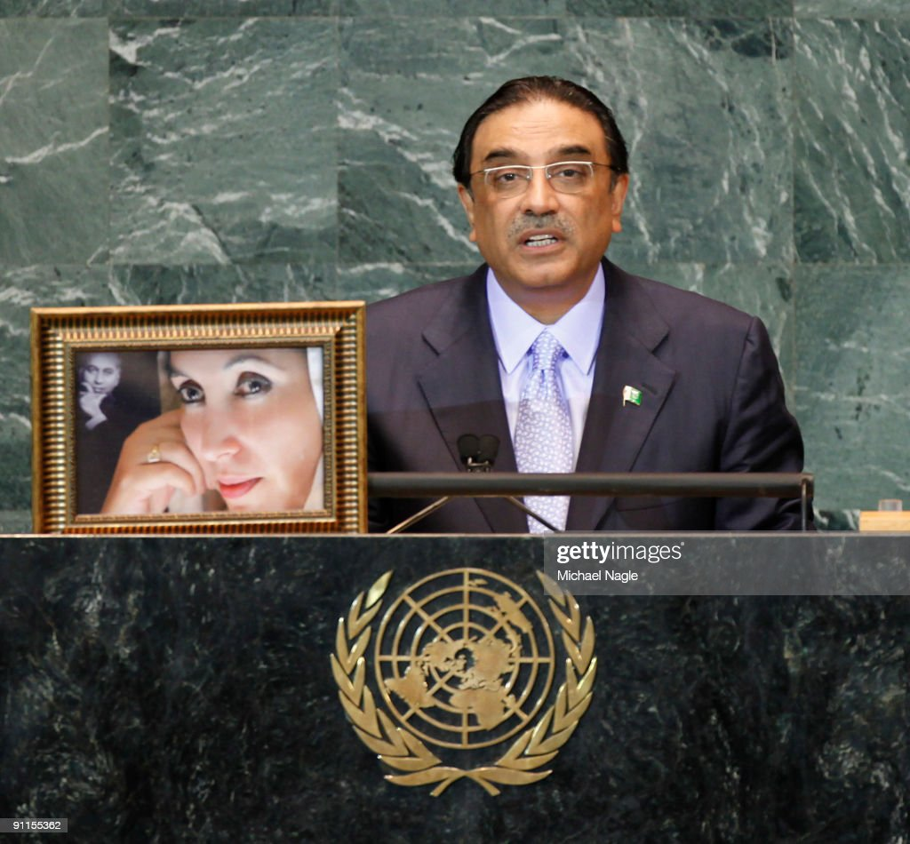 President of Pakistan Asif Ali Zardari holds a photo of his late wife former Prime Minister Benazir Bhutto as he addresses the United Nations General Assembly at the UN headquarters on September 25, 2009 in New York City. The United Nations General Assembly is meeting for their 64th session featuring leaders from over 120 countries.