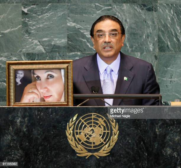 President of Pakistan Asif Ali Zardari holds a photo of his late wife former Prime Minister Benazir Bhutto as he addresses the United Nations General...