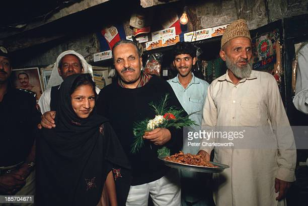 President of Pakistan General Mohammad Zia AlHaq stops to talk with villagers and to buy some snacks as he and his entourage drive back to his Murree...