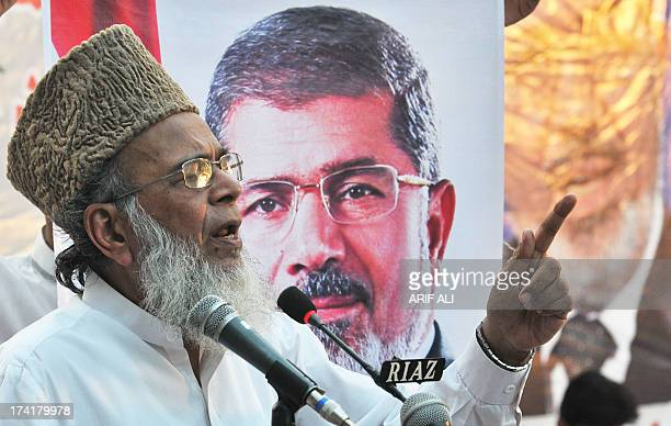 President of Pakistan's JamaateIslami party Syed Munawar Hassan addresses supporters during a rally in support of ousted Egyptian president Mohamed...