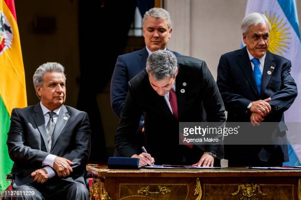 President of Paraguay Mario Abdo signs the agreement of Santiago after the Meeting of Presidents of South America also called ProSur on March 22 2019...