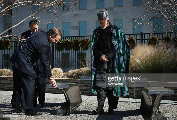 President of Pentagon Memorial Fund James Laychak touches the banch of his brother David Laychak as he and US Secretary of Defense Leon Panetta...