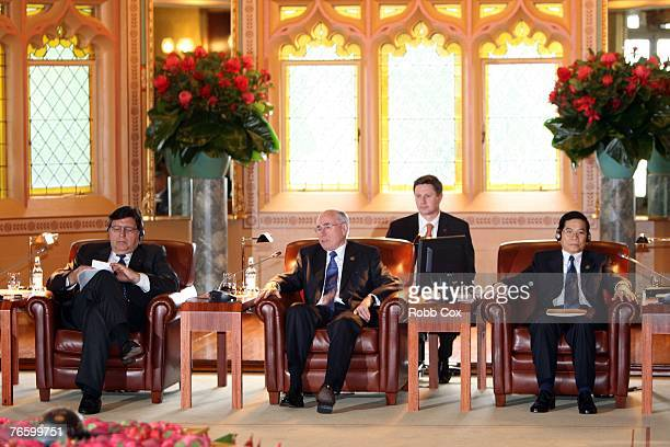 President of Peru Alan Garcia Australian Prime Minister John Howard and Vietnamese State President Nguyen Minh Triet are seen at the Leaders Retreat...