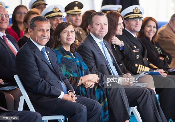President of Peru Ollanta Humala smiles next to Peruvian Minister of Foreing Affairs Ana Maria Sanchez Vargas de Rios and Minister of Defence Jakke...