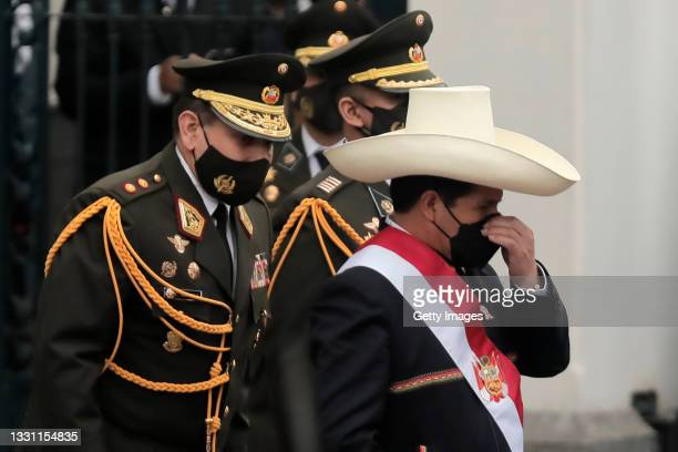 President of Peru Pedro Castillo adjusts his protective mask as he leaves Congress after the presidential inauguration on July 28, 2021 in Lima,...