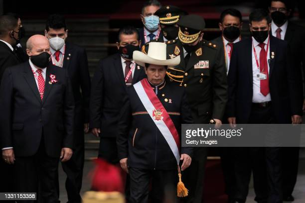 President of Peru Pedro Castillo walks out of Congress wearing the presidential sash after the presidential inauguration on July 28, 2021 in Lima,...