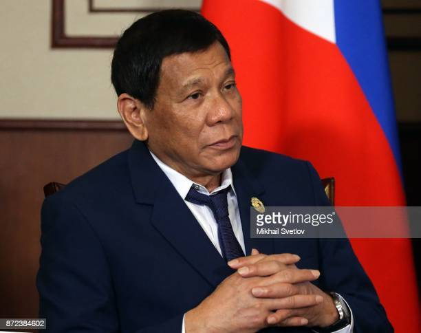 President of Philippines Rodrigo Duterte gestures during his meetng with Russian President Vladimir Putin at the APEC Leaders Summit on November...
